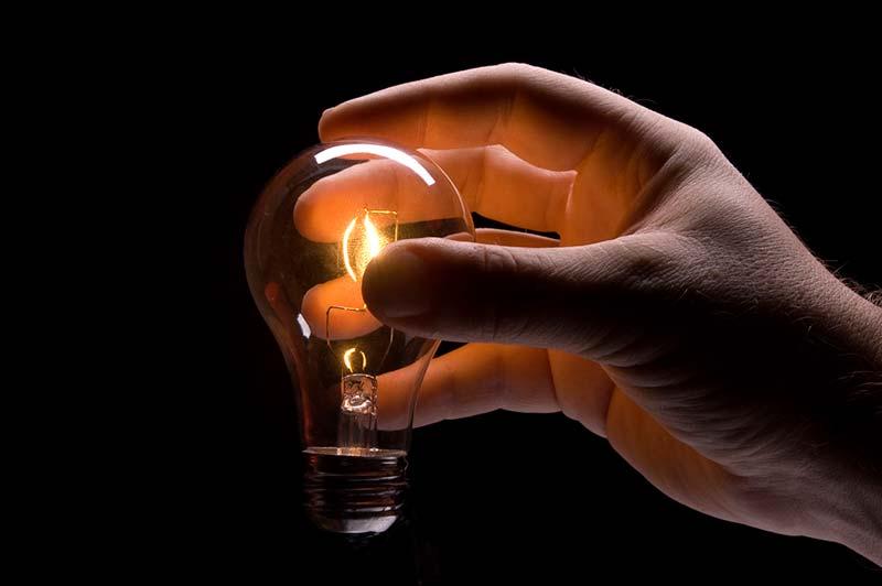 hand-holding-lit-lightbulb