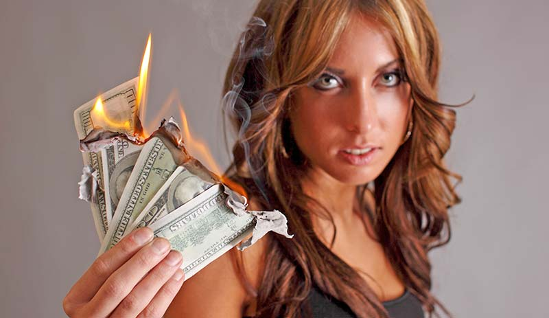 woman-burning-money