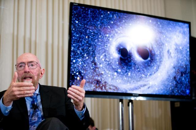 Laser Interferometer Gravitational-Wave Observatory (LIGO) Co-Founder Kip Thorne speaks next to a visual of gravitational waves from two converging black holes, right, during a news conference at the National Press Club in Washington, Thursday, Feb. 11, 2016, to announce that scientists they have finally detected gravitational waves, the ripples in the fabric of space-time that Einstein predicted a century ago. The announcement has electrified the world of astronomy, and some have likened the breakthrough to the moment Galileo took up a telescope to look at the planets. (AP Photo/Andrew Harnik)